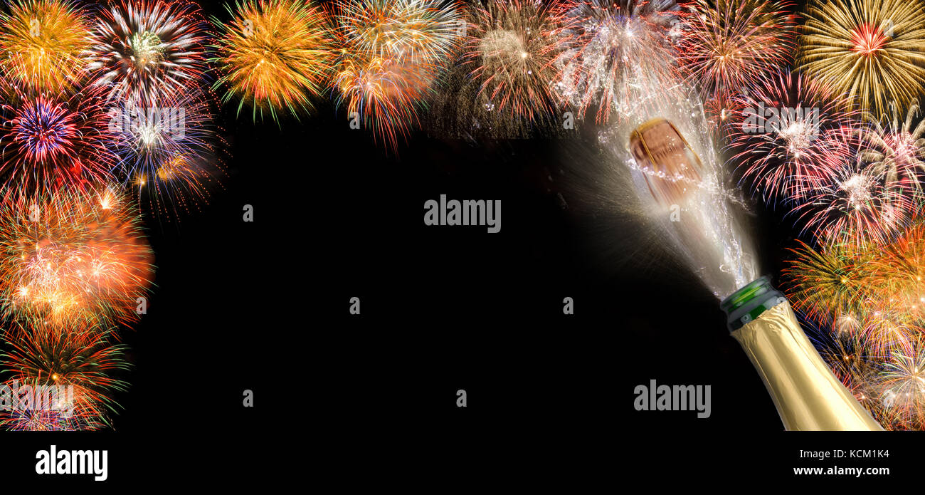 popping cork of champagne with fireworks for new year' s 2018 - Stock Image