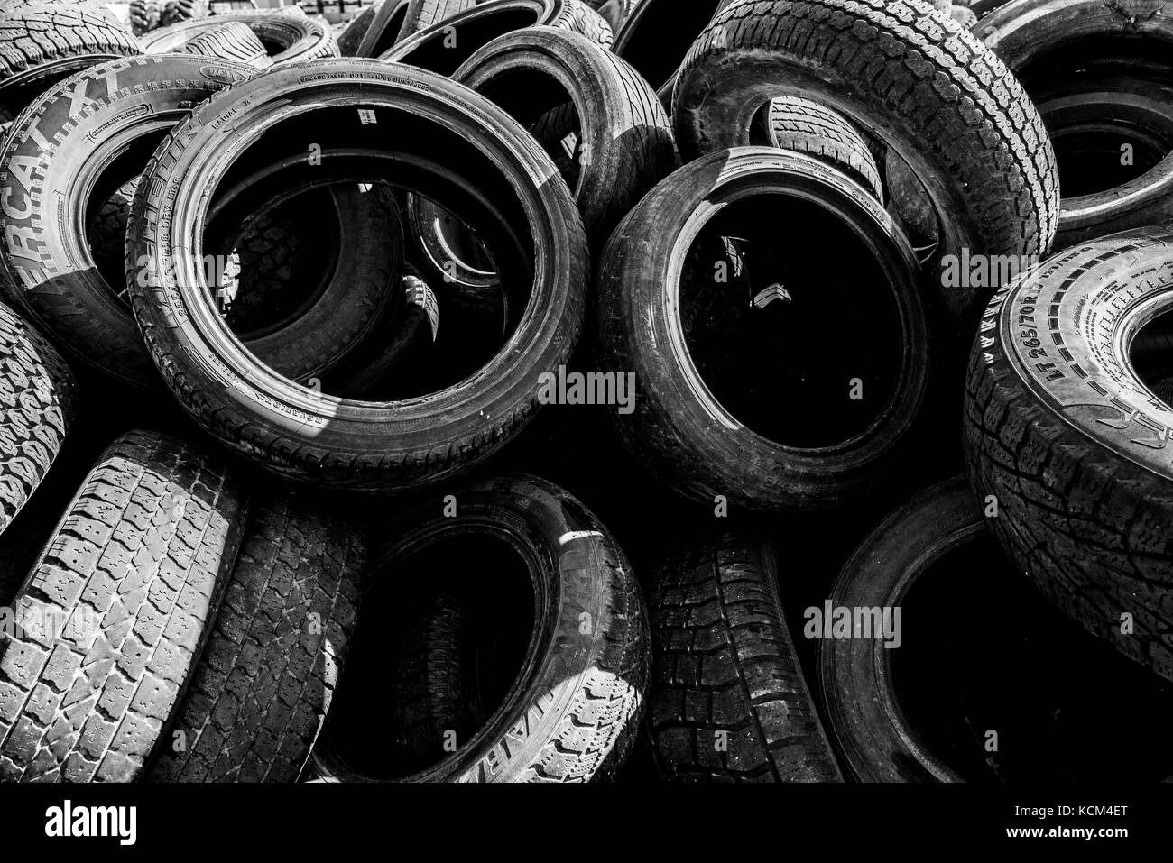 Pile of used cat tires - Stock Image