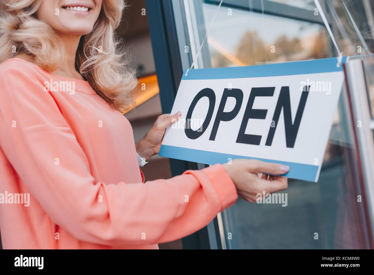 cafe owner with sign open  - Stock Image