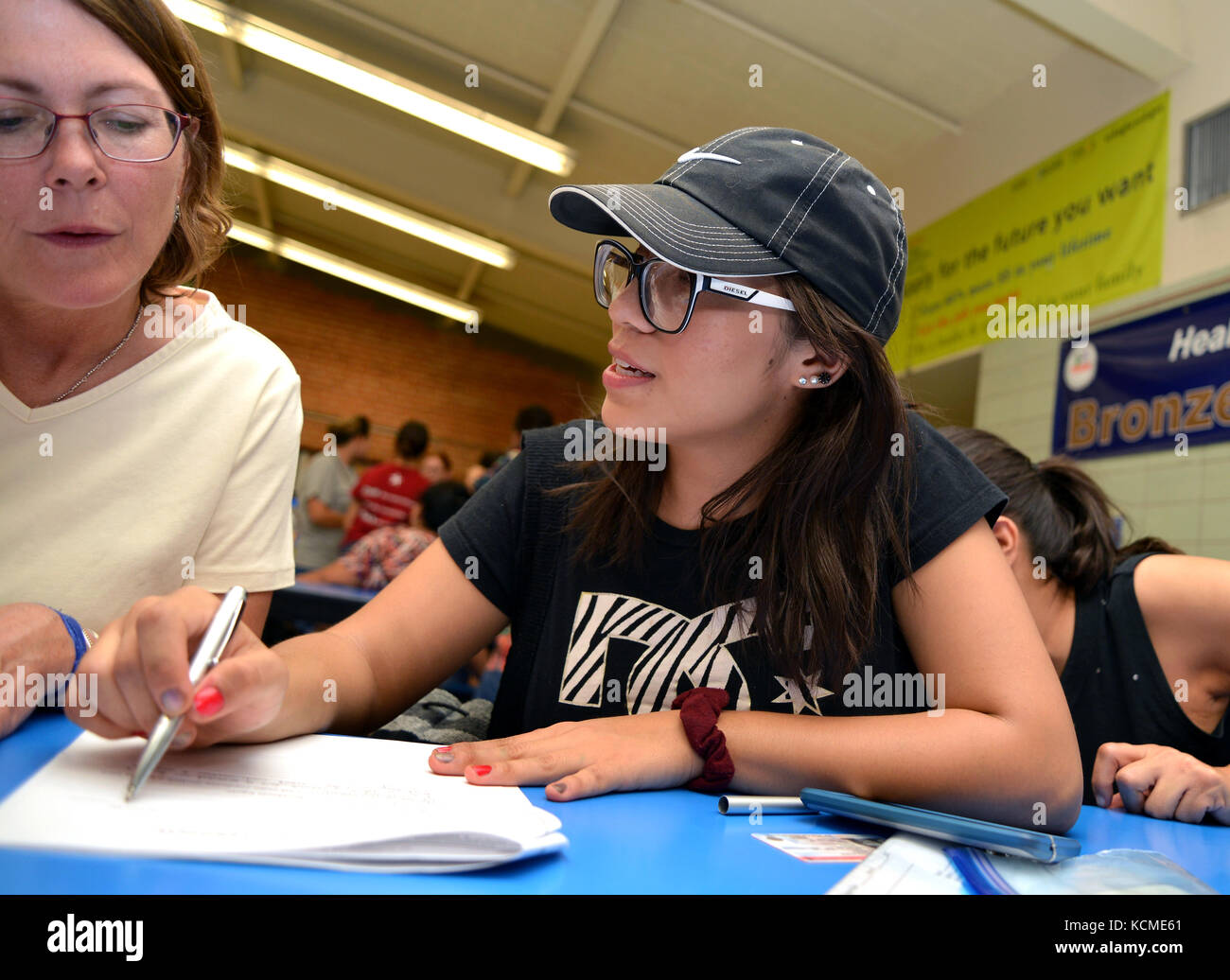Volunteers from Keep Tucson Together and attorney Margo Cowan provide legal assistance to persons effected by changes to DACA, or Deferred Action Chil Stock Photo