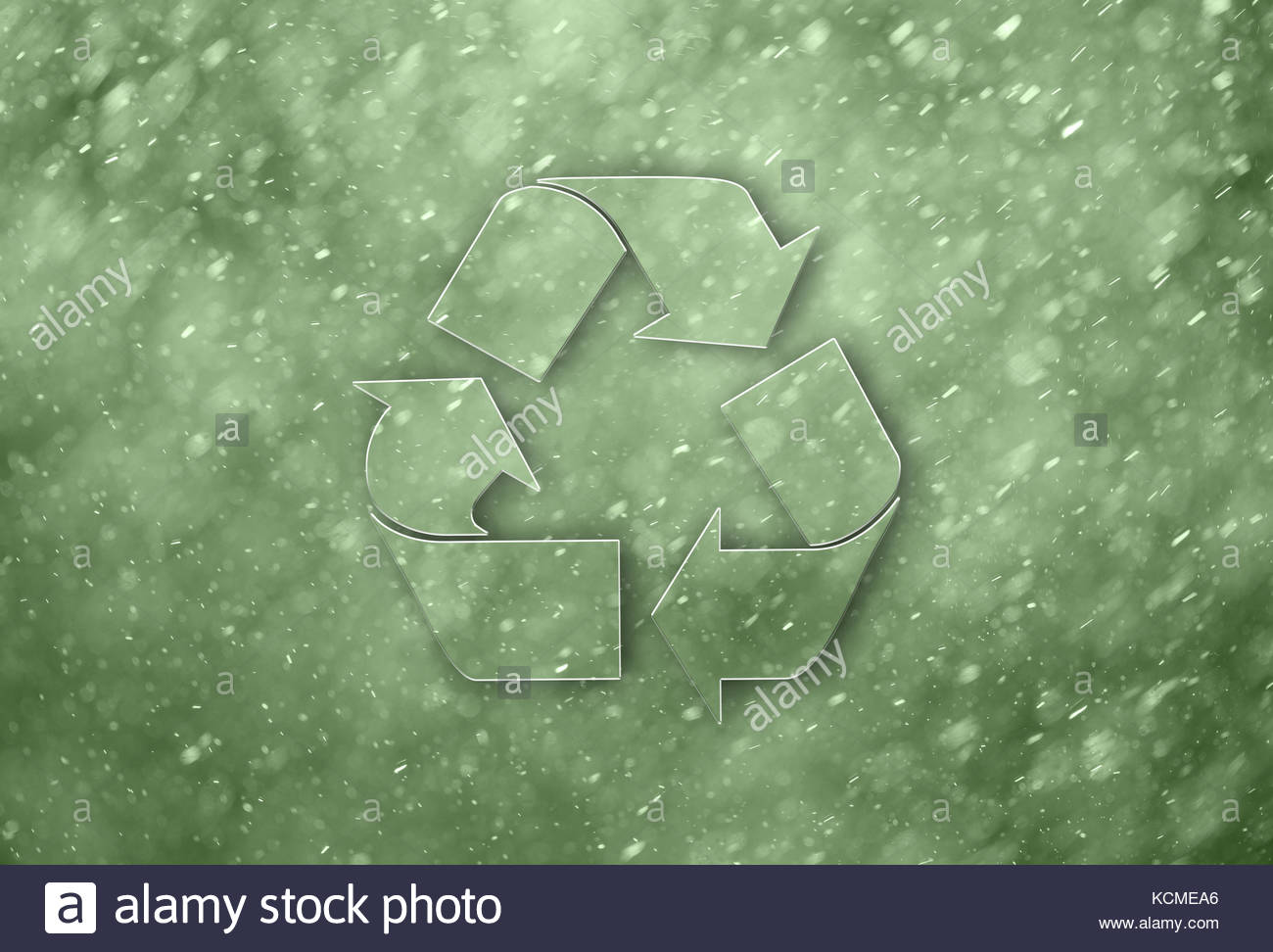 Creative green color recycle symbol on abstract rainy green blurred background. Lovely recycle symbol with blurred - Stock Image