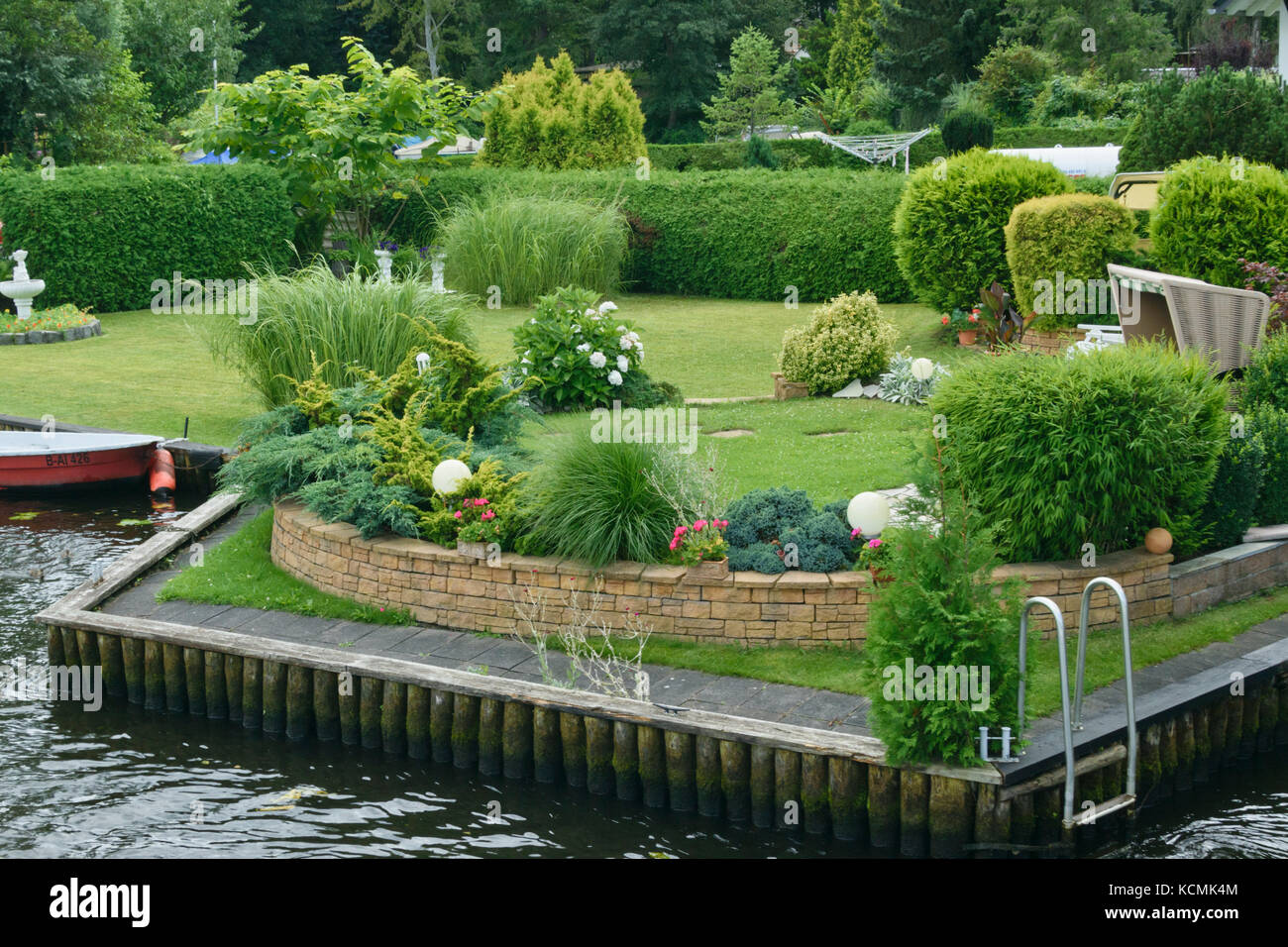 Garden on a water property - Stock Image