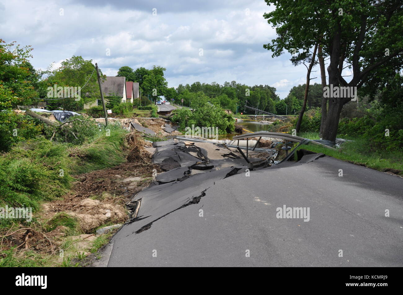 The power of nature. The century flood has swept away a road near Magdeburg, near the village of Niegripp. - Stock Image