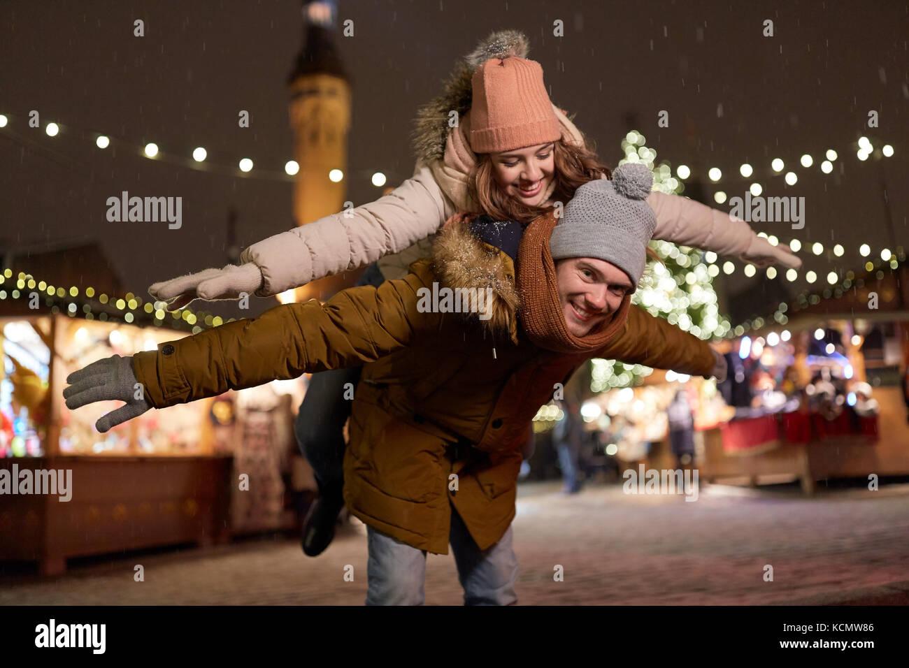 happy couple having fun at christmas market - Stock Image
