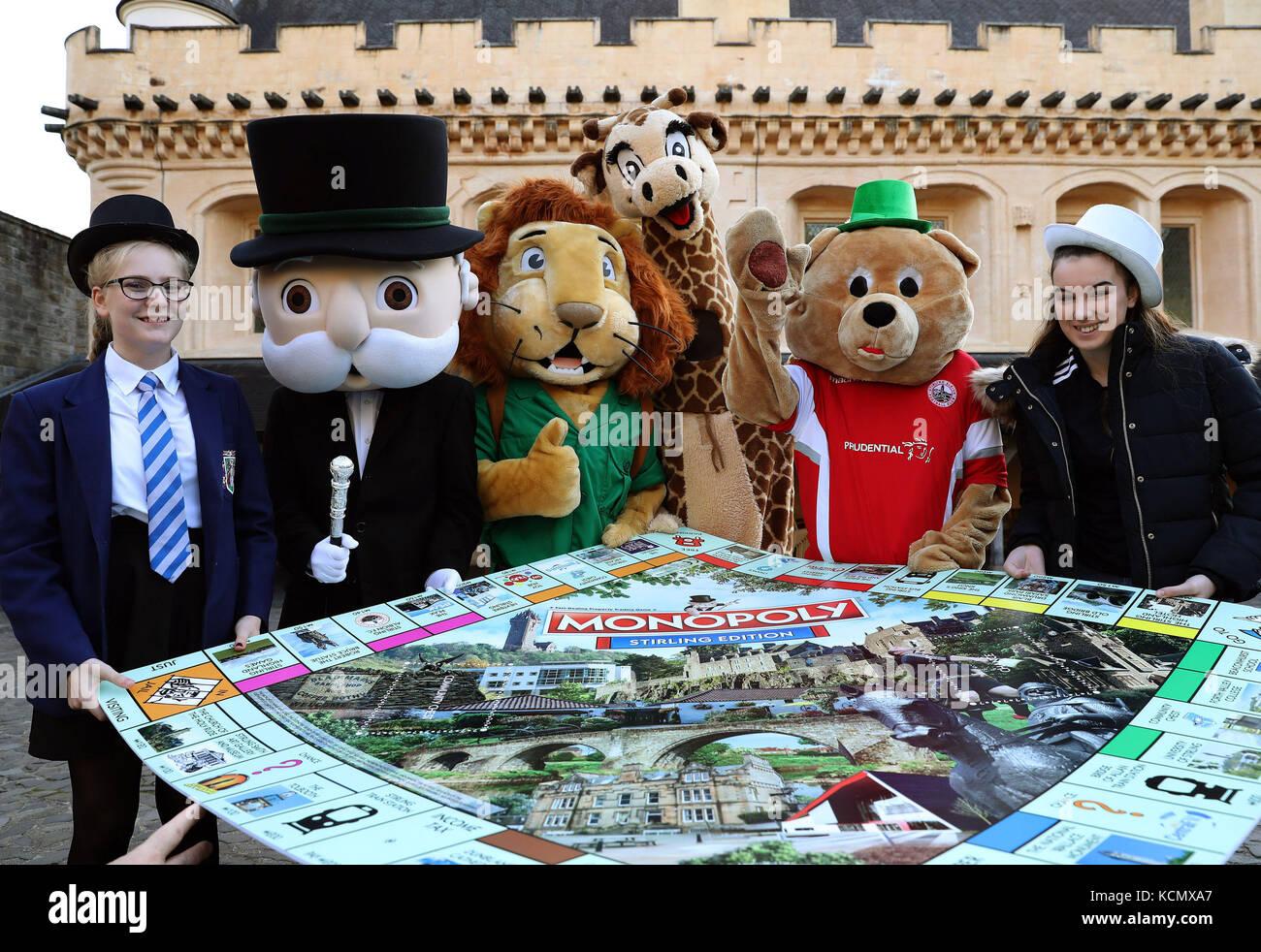 (left to right) 13 year old Mary Peck, Mr Monopoly, Blair Drummond Safari Park mascots Safari Sam and Gary The Giraffe, - Stock Image