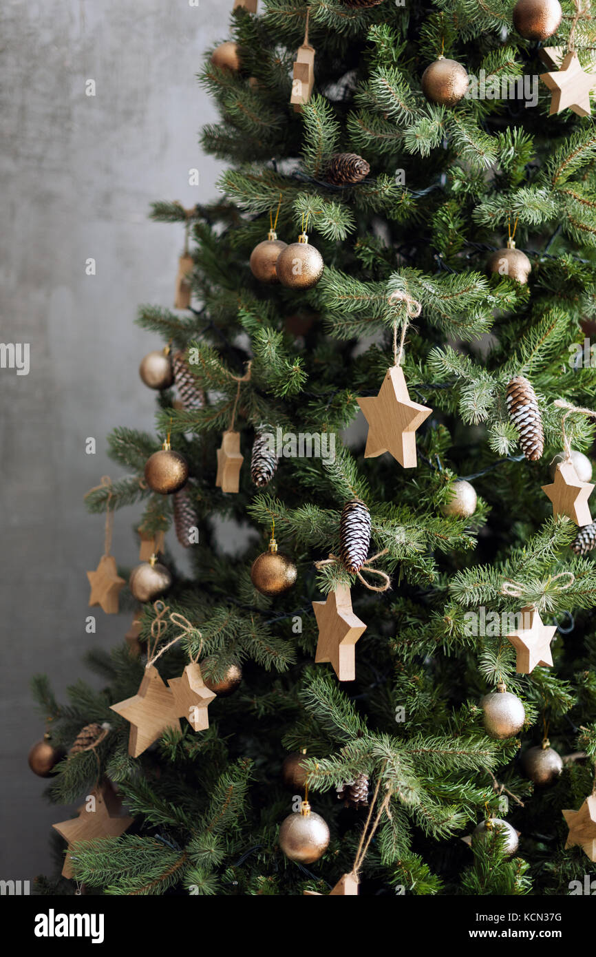 Christmas Tree With Wooden Rustic Decorations In Loft