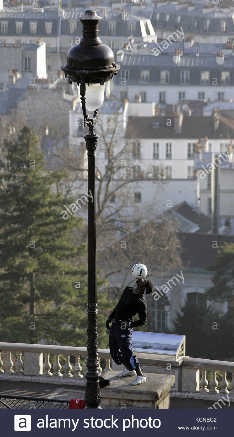 A man juggling with a ball in street, Montmartre, Paris 18e Stock