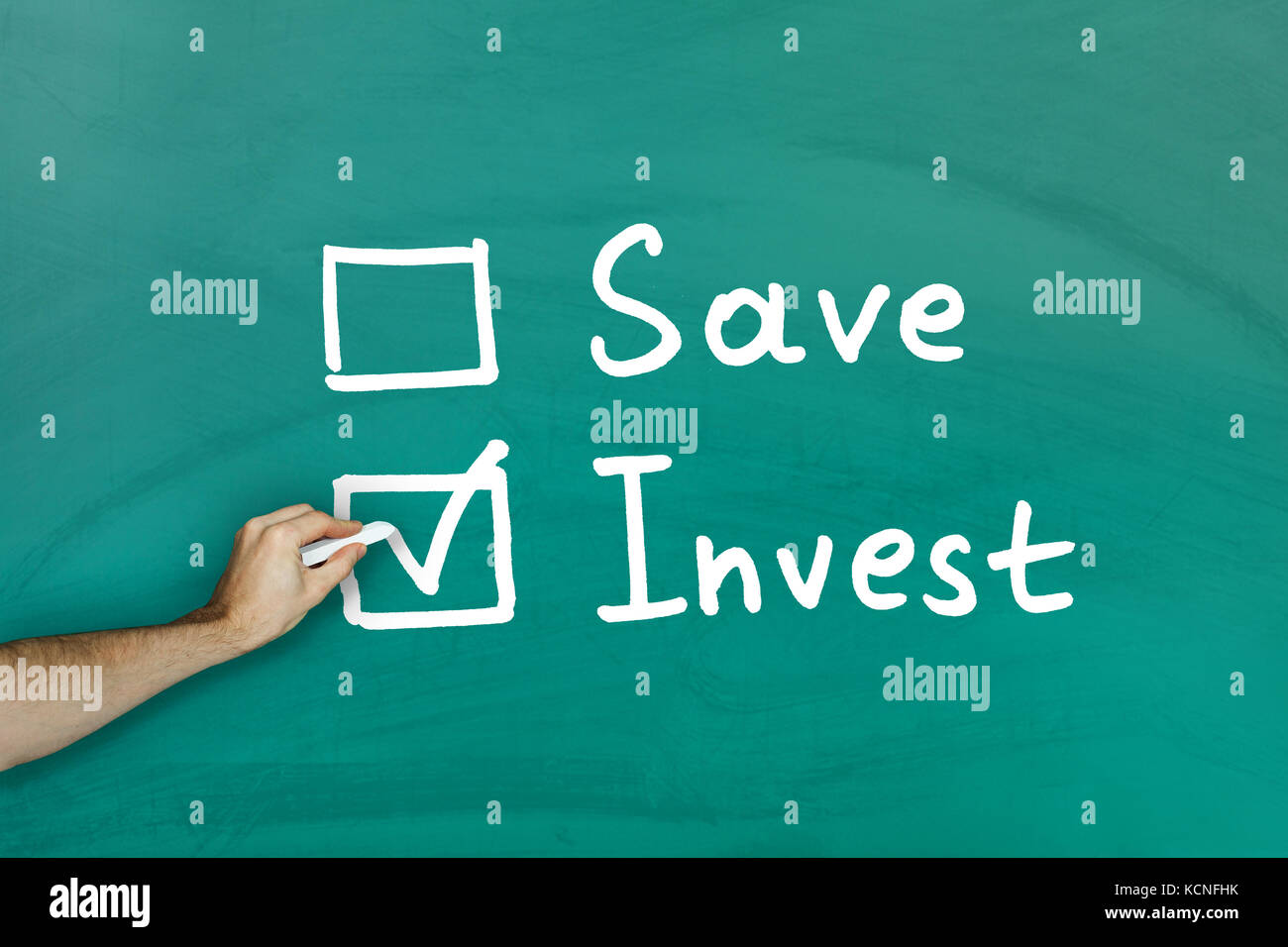 Invest instead of saving concept on green blackboard - Stock Image