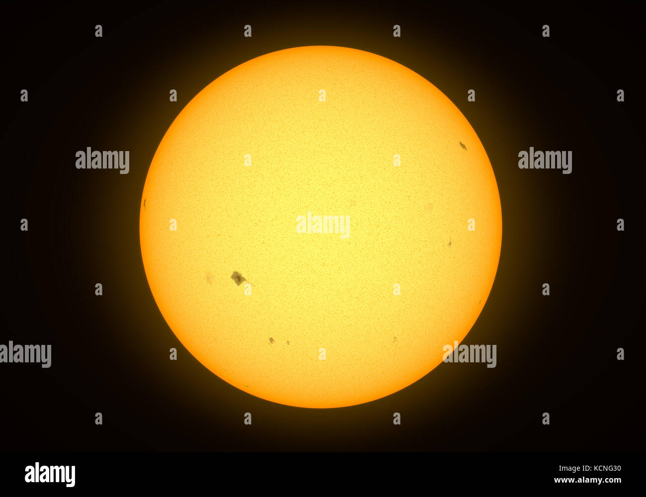 Yellow star with sunspots - Stock Image