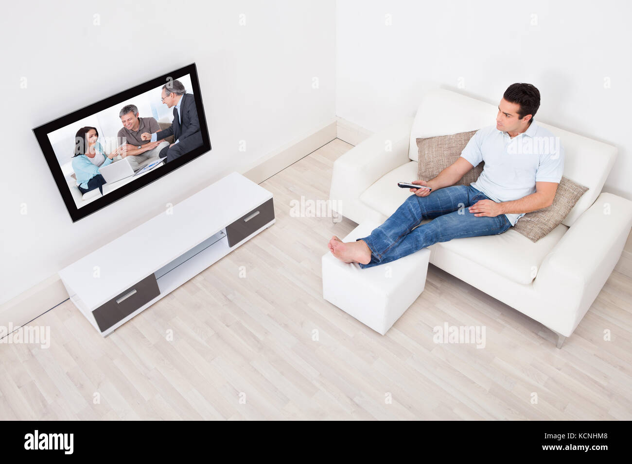 Young Man At Home Watching Movie On Television - Stock Image