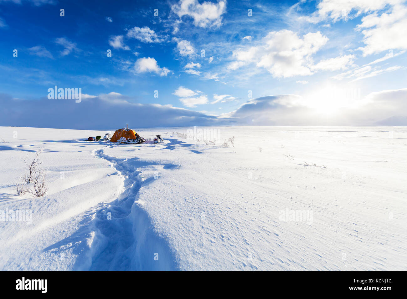 Snowmobilers winter camp while attempting to cross the North Canol heritage trail running between Yukon Territory - Stock Image