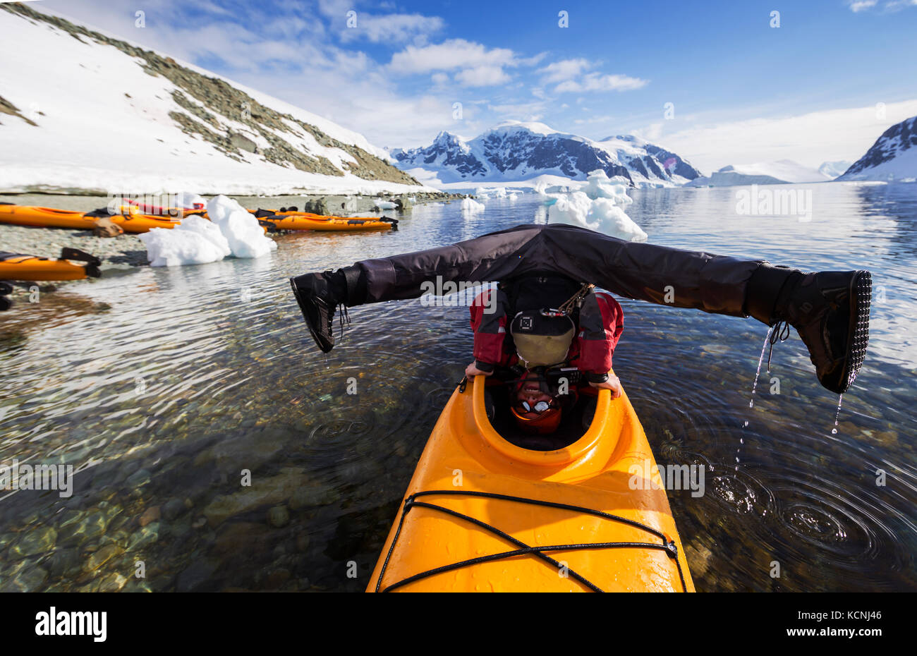 A Kayak guide demonstrates his unique balancing abilities with his Kayak while paddling in Danco Harbour, The Aantarctic - Stock Image