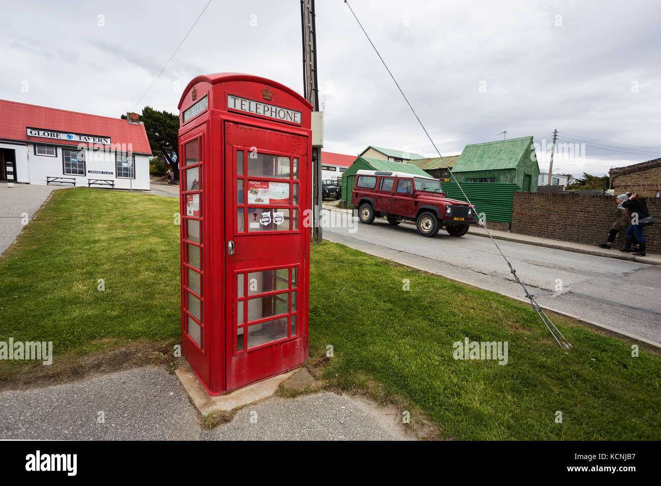 The town of Stanley, capital of the Falkland Islands maintains a sense of british heritage with its telephone booths - Stock Image