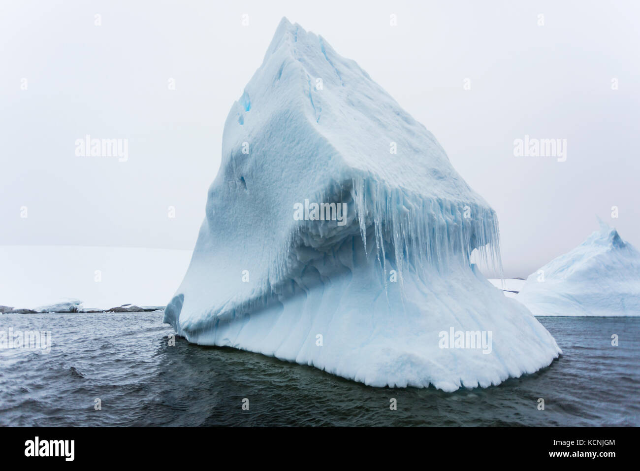 Grounded icebergs create beautiful designs as they slowly disintegrate into the cold waters surrounding Pleneau - Stock Image