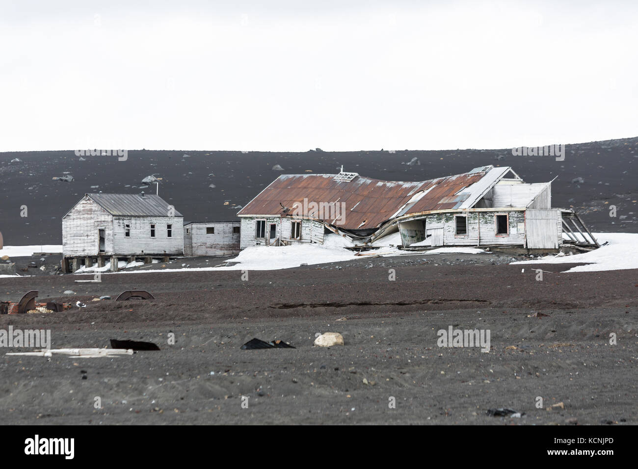 Abandoned buildings slowly give in to the elements in the bleak and harsh environment on Deception Island, South - Stock Image