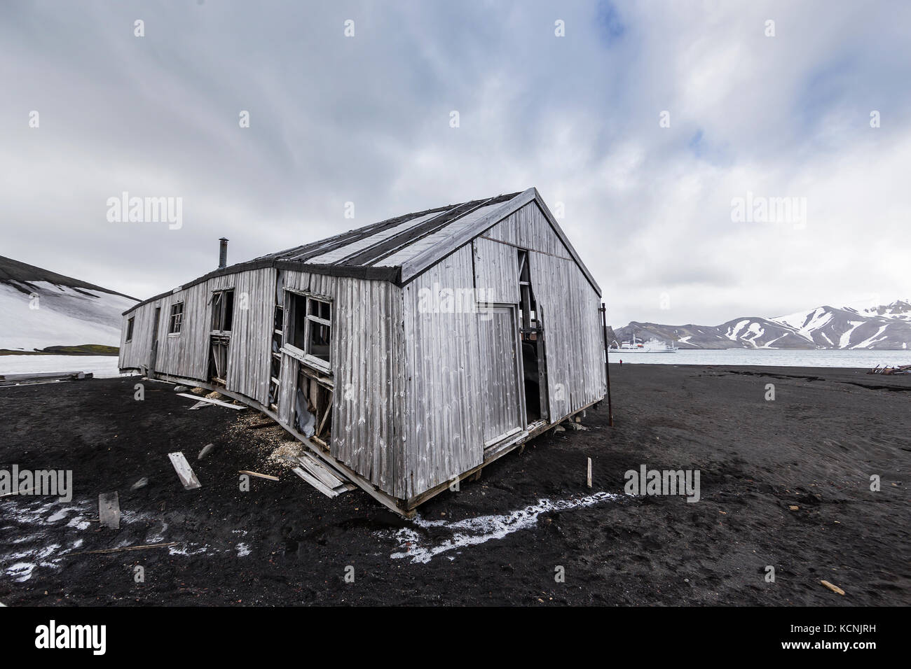 Long abandoned buildings slowly deteriate in the harsh and bleak environment at Deception Island, South Shetland - Stock Image