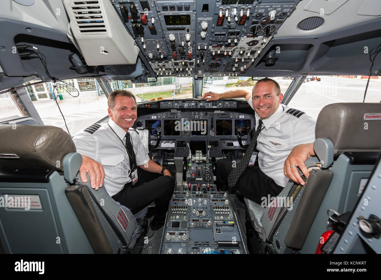 Interior view of a 737 cockpit and its two pilots,The Comox Valley - Stock Image