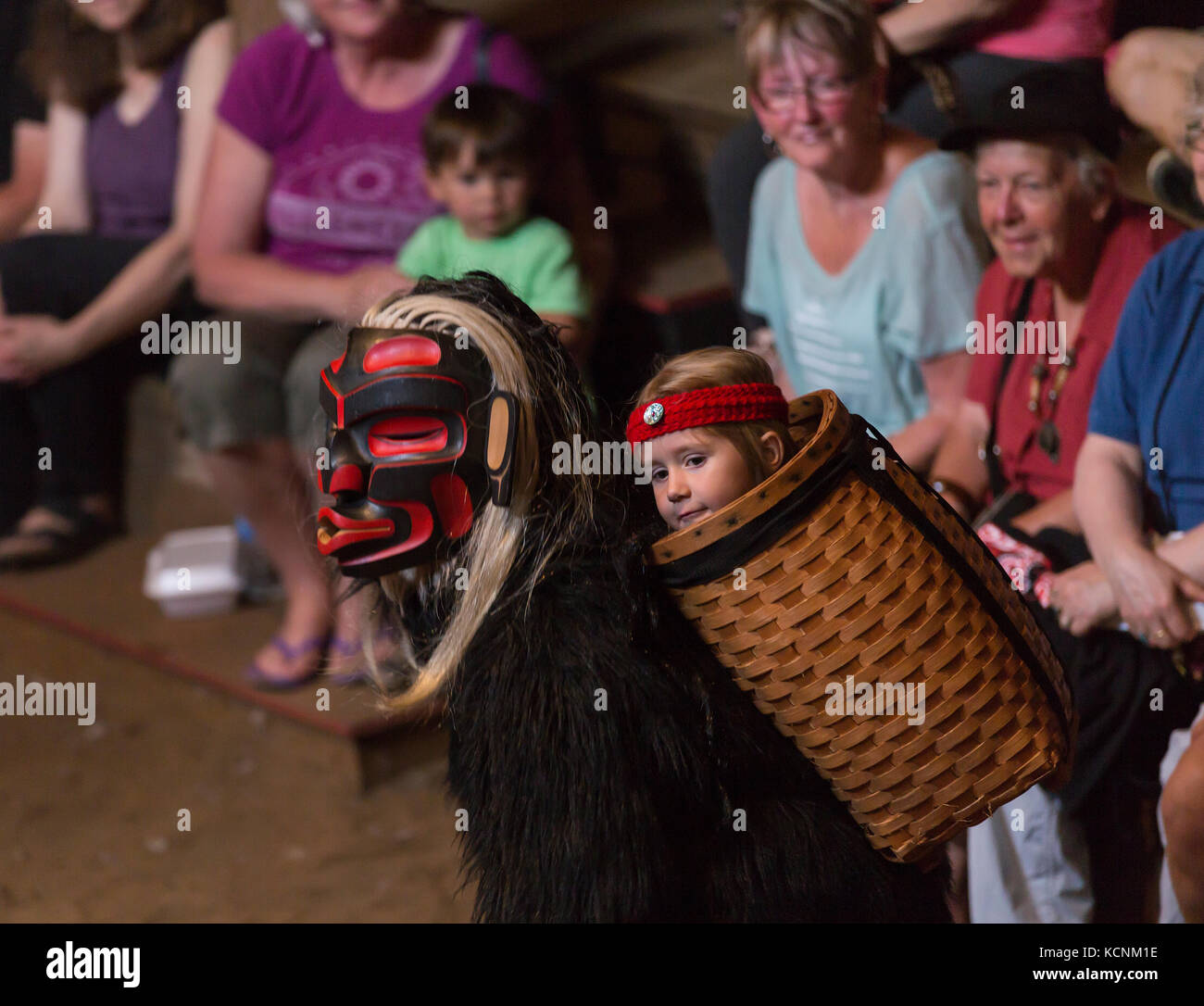 Dzunakwa, Wild woman of the woods and the keeper of children in first nation lore dances for visitors to the Komok's - Stock Image