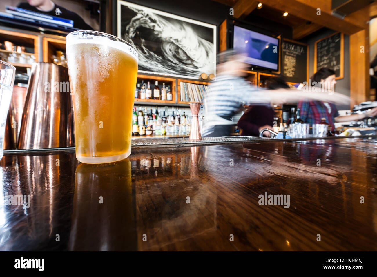 Craft beer is served cold at a local restaurant in Tofino, Pacific Rim, Vancouver Island, British Columbia, Canada. - Stock Image