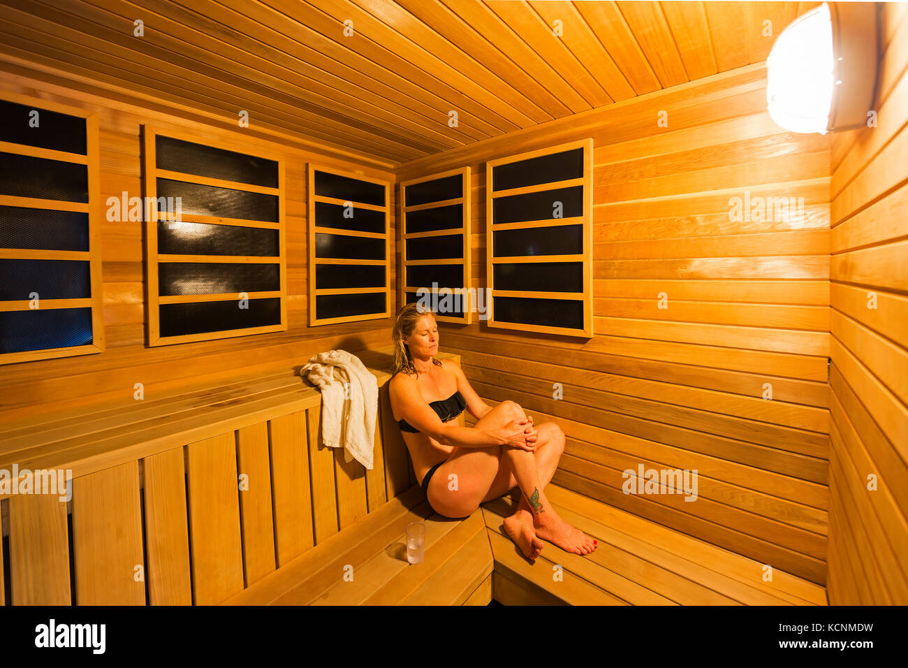 A spa visitor relaxes in a sauna at the Kingfisher Resort and Spa in Courtenay, Vancouver Island, British Columbia, - Stock Image