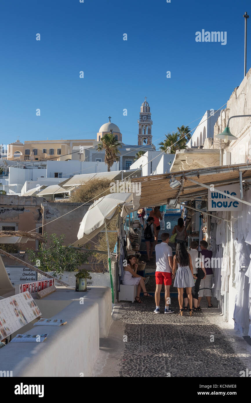 SANTORINI/GREECE 05 SEP 2017 - Tourists walking in the streets of Fira. - Stock Image