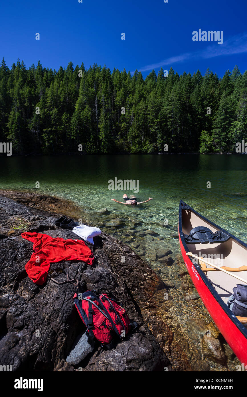 Village Bay Lakes on Quadra Island provides reprieve for a canoer during a hot summer day, Quadra Island, Discovery - Stock Image