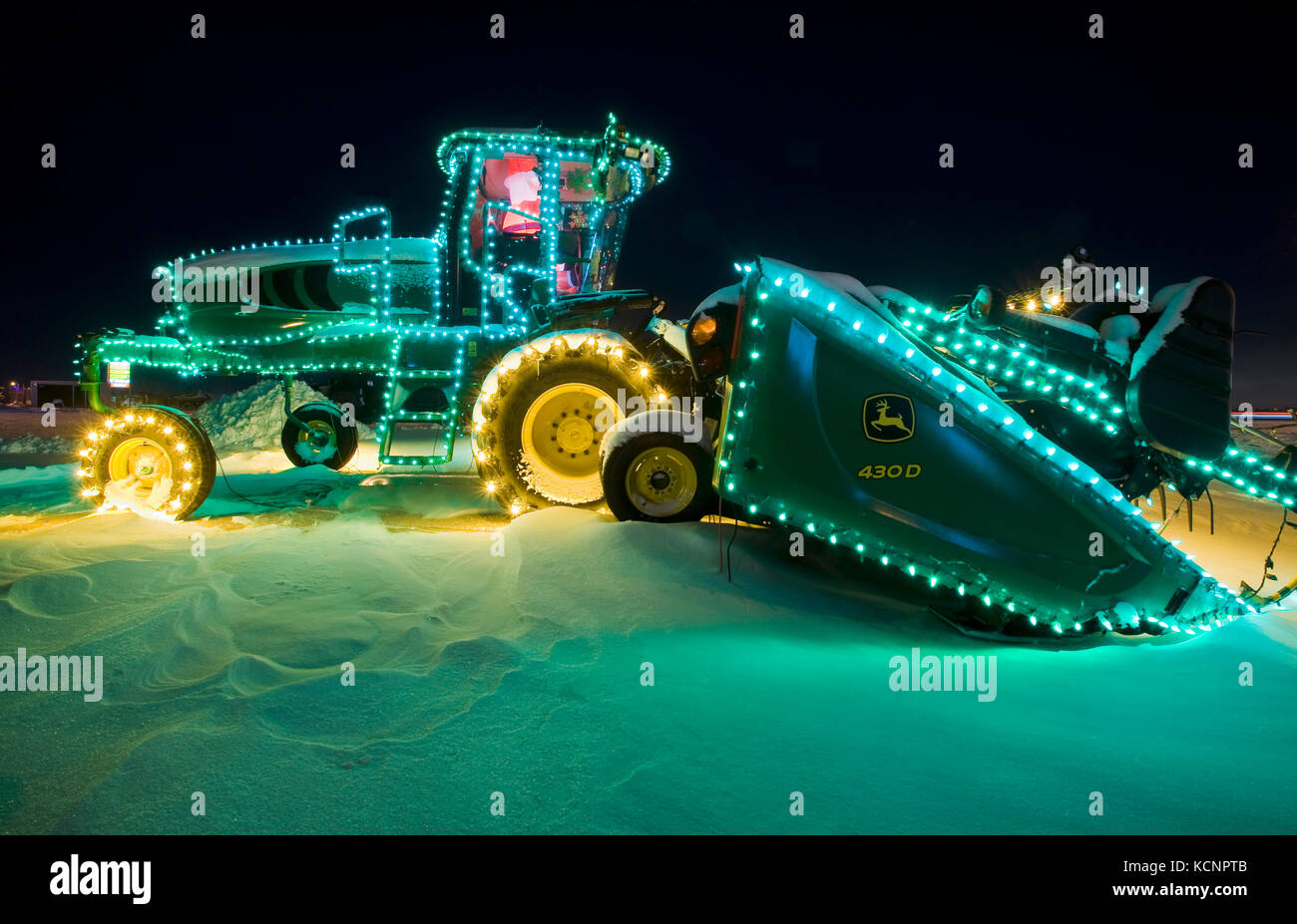 swather with Christmas lights, Manitoba, Canada - Stock Image