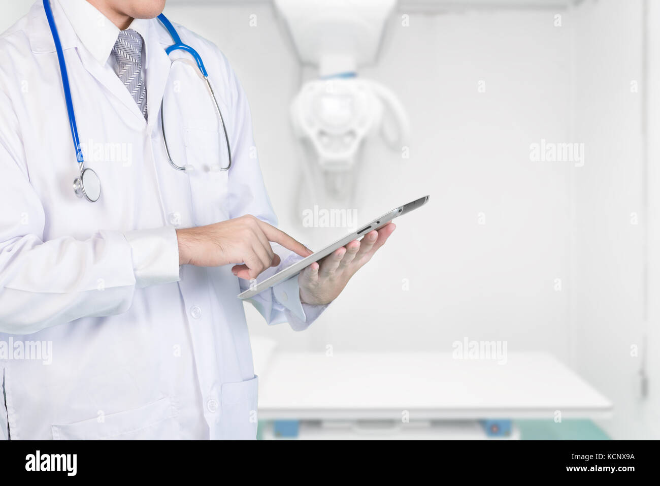 Doctor using digital tablet check result in x-ray room. Concepts of 4.0 technology communication. copy space. - Stock Image