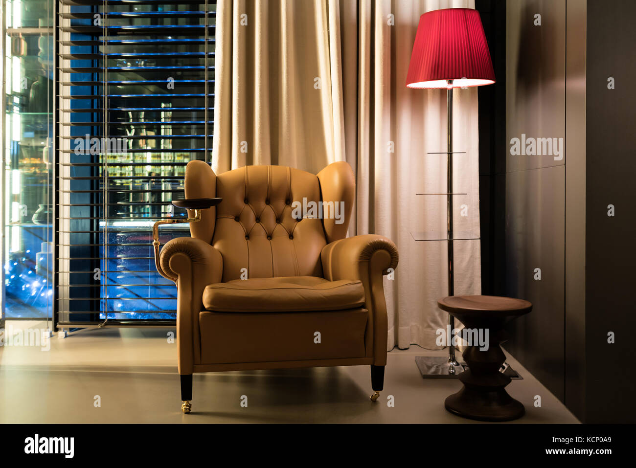 Leather armchair coffee table and floor lamp in lobby at hotel stock leather armchair coffee table and floor lamp in lobby at hotel interior design of classic leather chair and lamp in dim room aloadofball Image collections