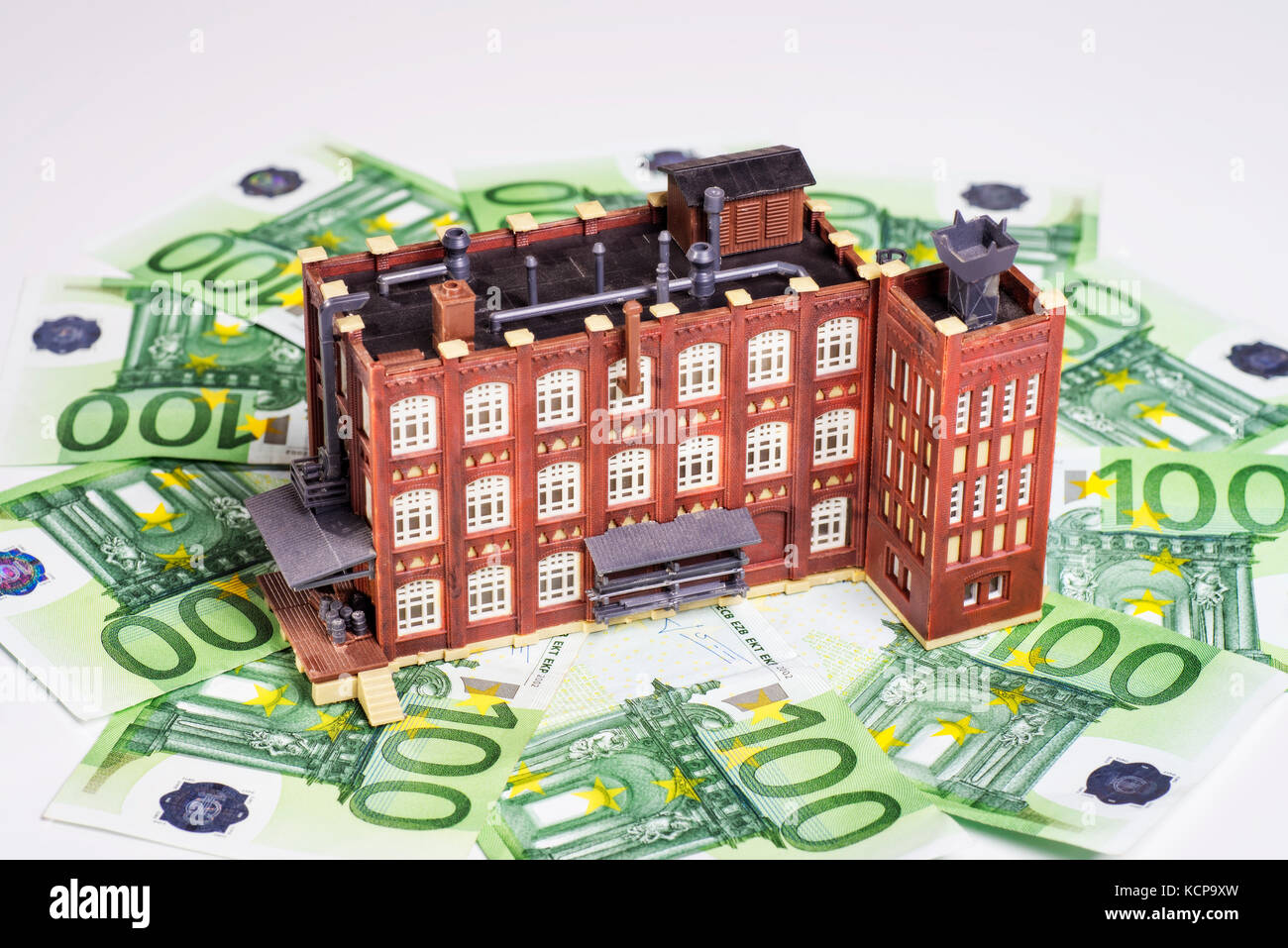 Factory building is surrounded by euro banknotes. - Stock Image