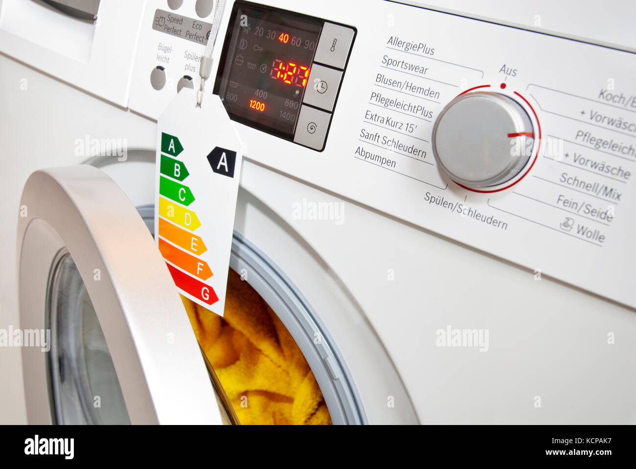 Modern Washing Machine With Eco Label, Showing Efficiency Class A.   Stock  Image