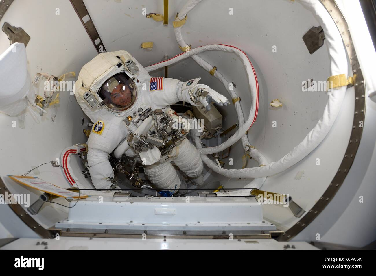 International Space Station Expedition 53 crew member Mark Vande Hei prepares for his spacewalk to install a new - Stock Image