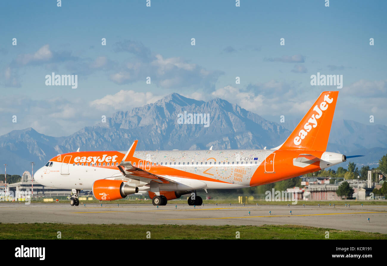 An Easyjet Airbus A320-214 taxiing at Milan's Linate Airport. The airplane is decorated to celebrate Easyjet's - Stock Image