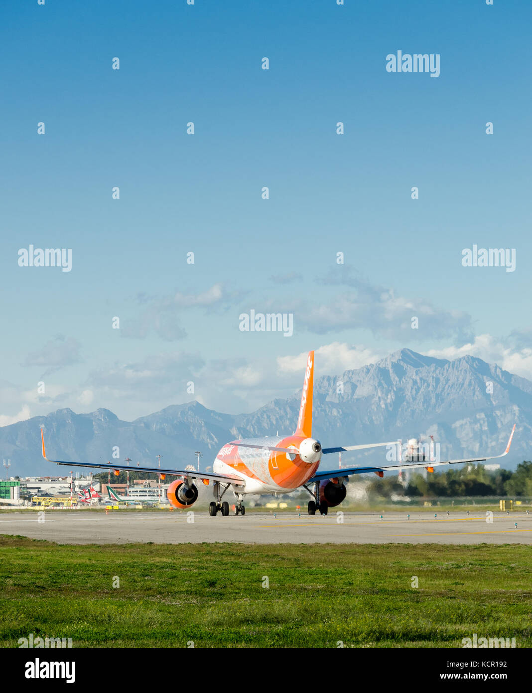 An Easyjet Airbus A320-214 taxiing at Milan's Linate Airport. The airplane is decorated to celebrate Easyjet's 20 Stock Photo