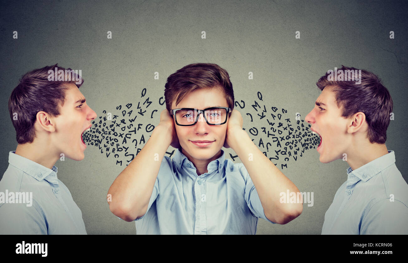 Two angry men screaming at peaceful guy covering his ears with hands ignoring them, alphabet letters coming out - Stock Image
