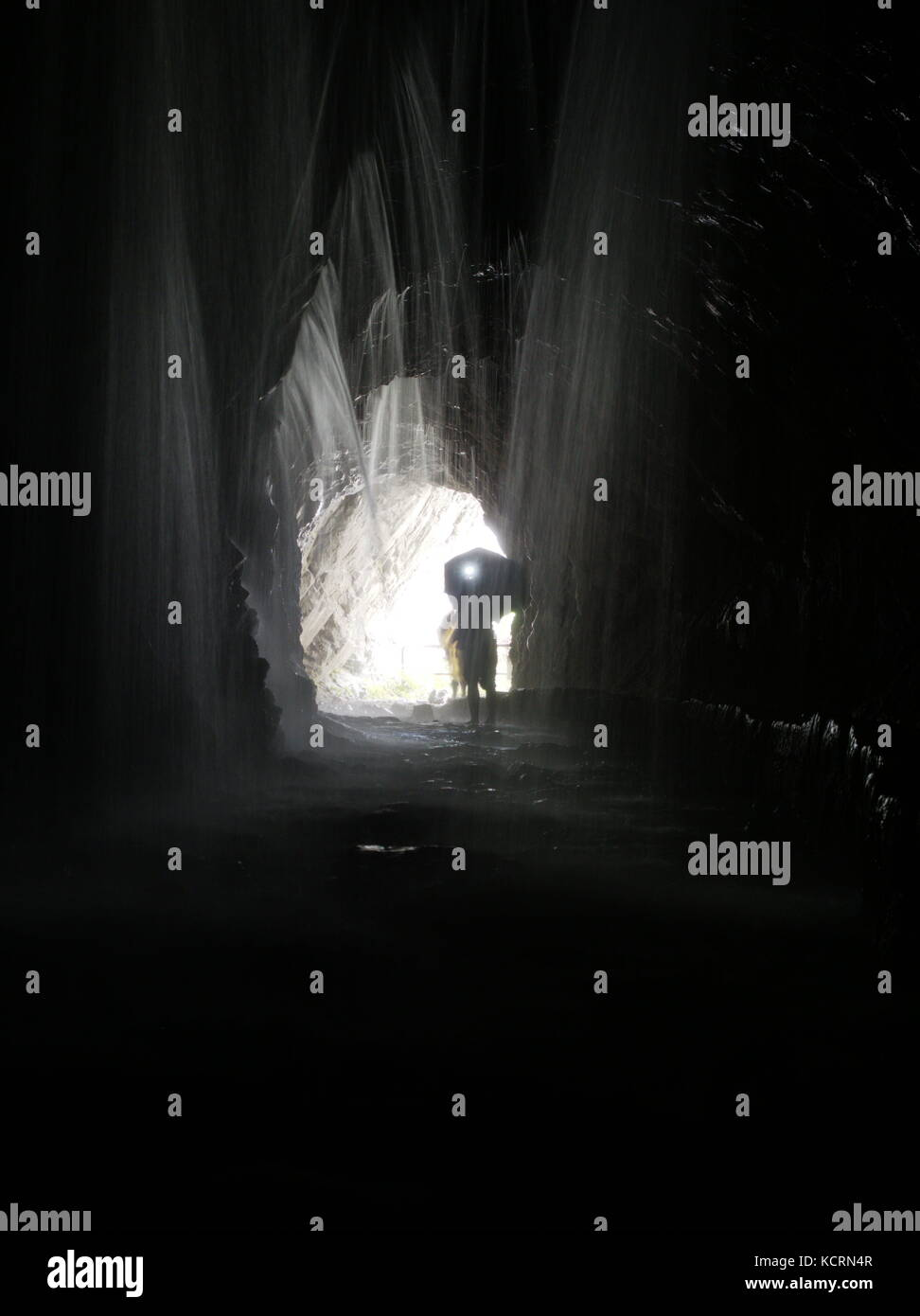 Visitor walking through the Cave of Water Curtain in Hualien, Taiwan - Stock Image