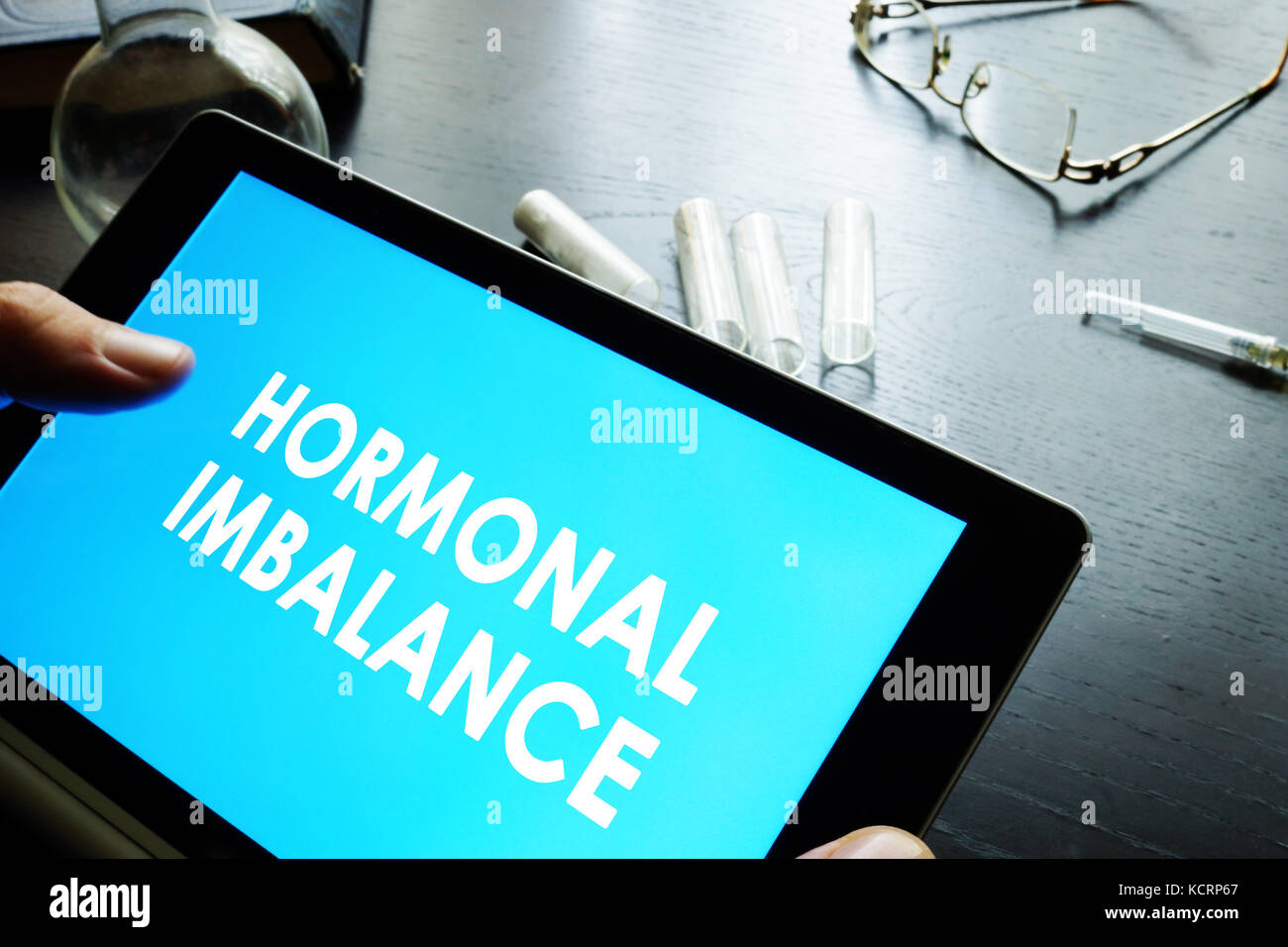 Hormonal imbalance sign on a tablet. - Stock Image