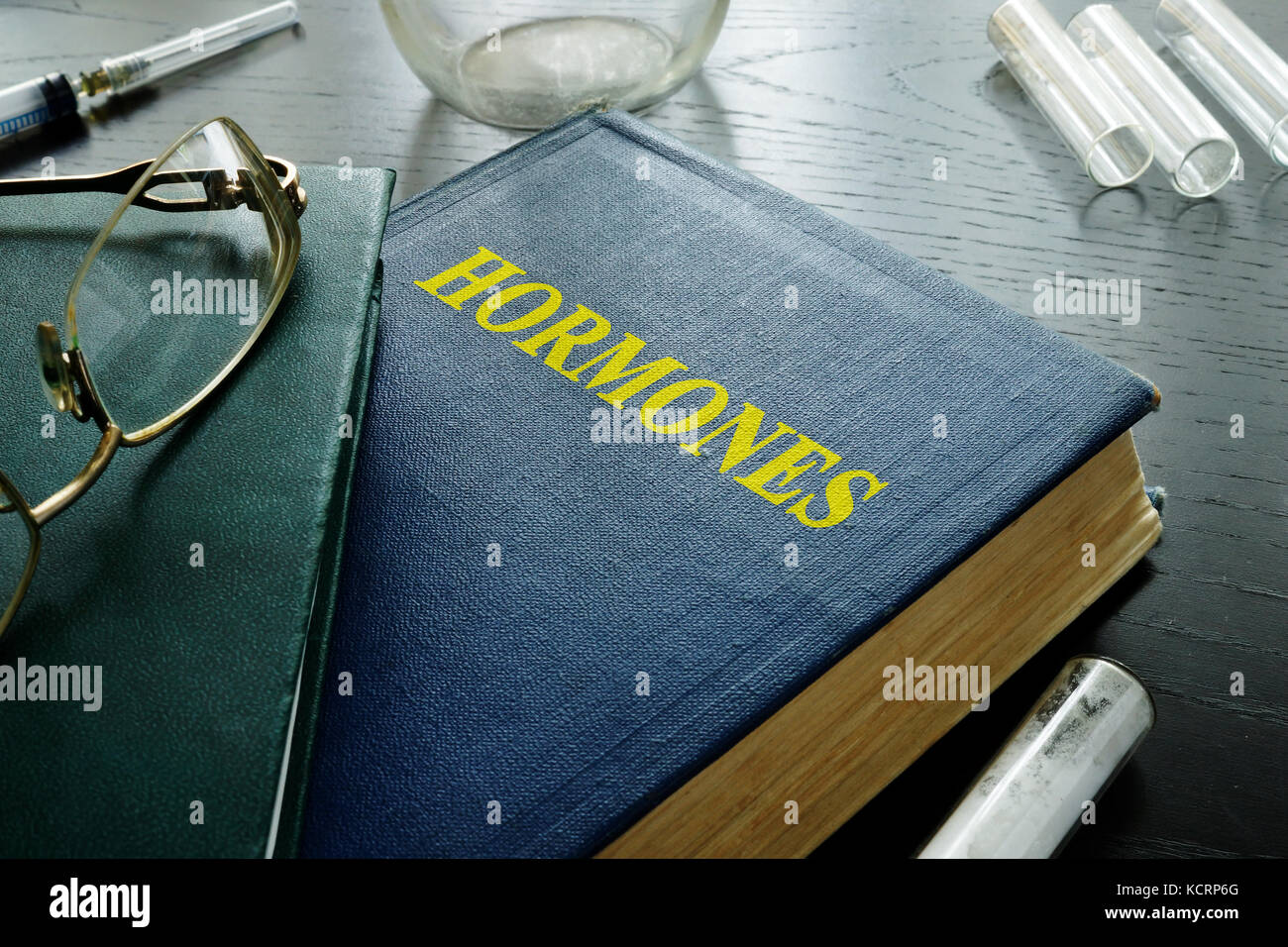 Book with title hormones on a desk. - Stock Image