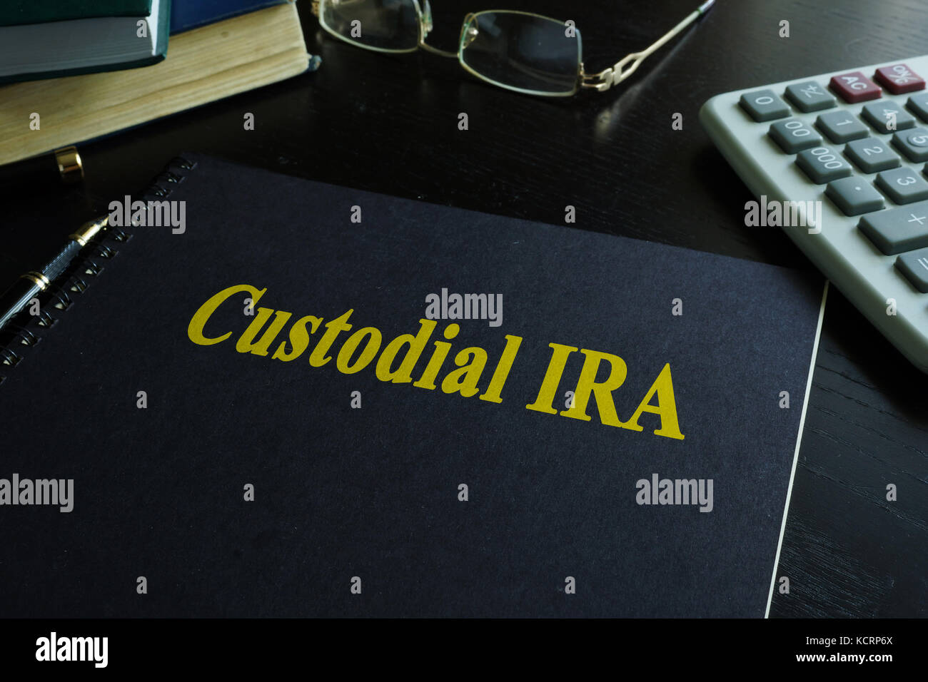 Book with title Custodial IRA on a desk. - Stock Image