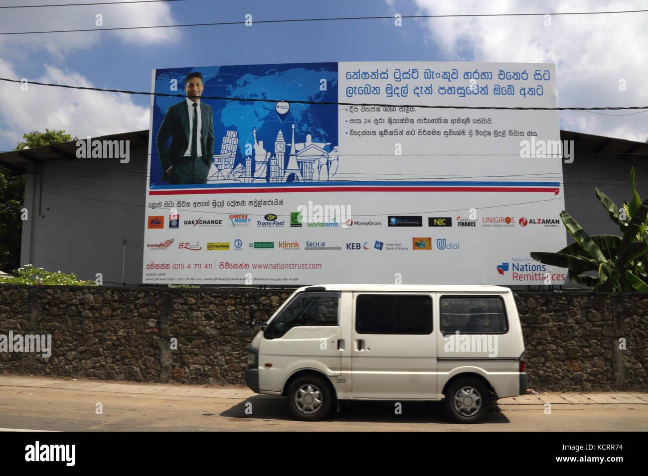 Galle Sri Lanka Mini Van parked under National Trust Billboard Stock Photo