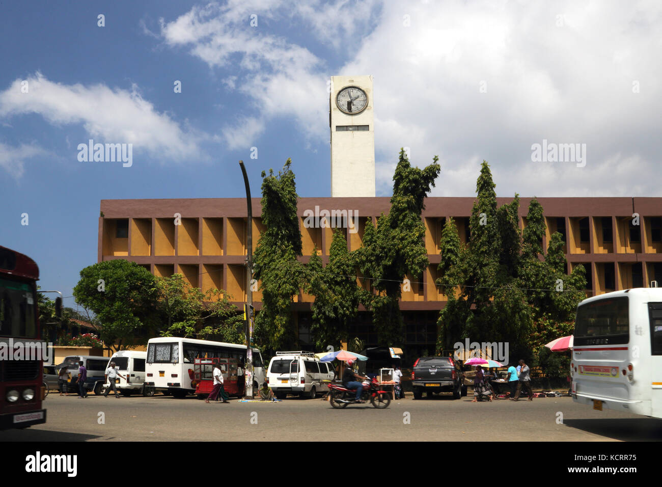 Galle Sri Lanka Street Vendors outside Building With Clock Tower - Stock Image