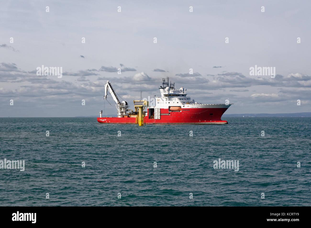 The Fugro Saltire at the Rampion Offshore Windfarm, near Brighton, England. - Stock Image