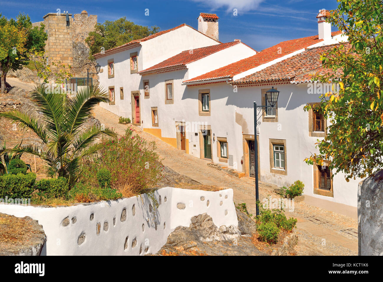 Portugal: Picturesque small road with white washed houses leading to  medieval castle of Marvao - Stock Image