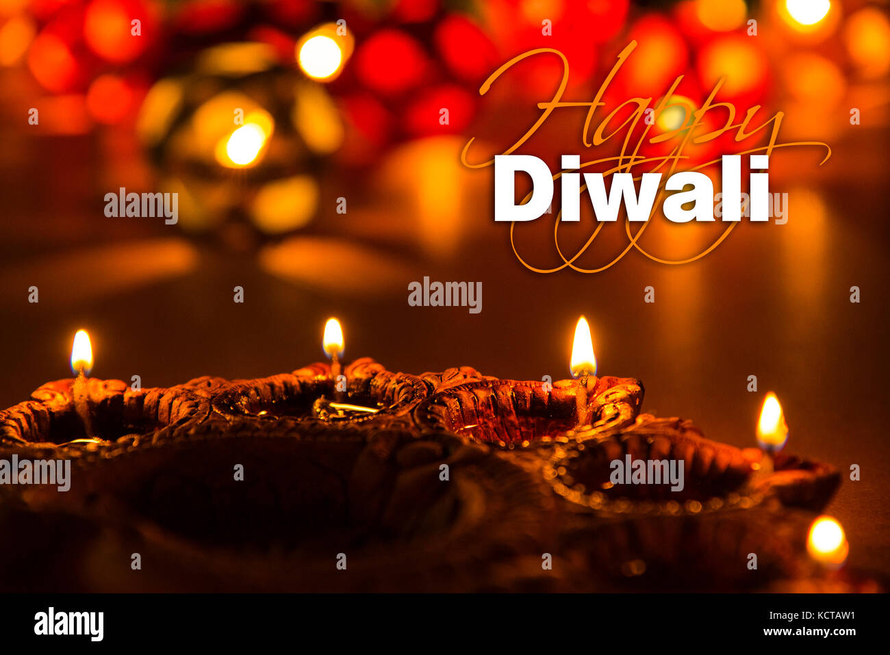 Stock photo of diwali greeting card showing illuminated diya or oil lamp or panti with Happy Diwali text Stock Photo