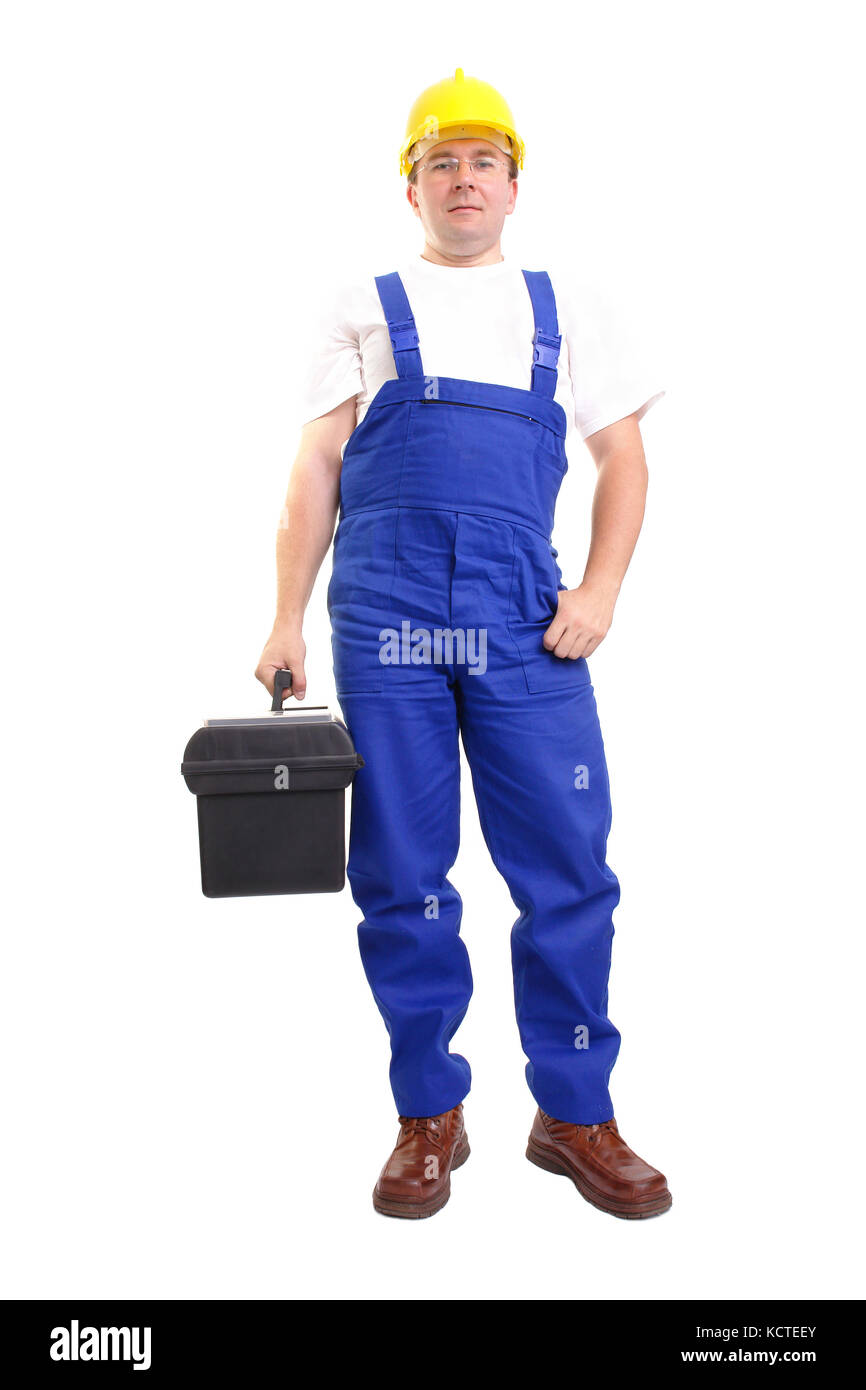 Service man wearing blue helmet and overall holding black toolbox over white - Stock Image