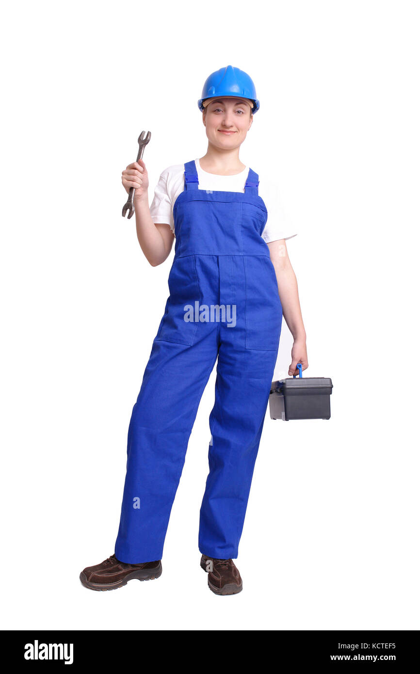 Servicewoman wearing blue helmet and overall holding black toolbox in one hand and flat wrench in another hand over - Stock Image