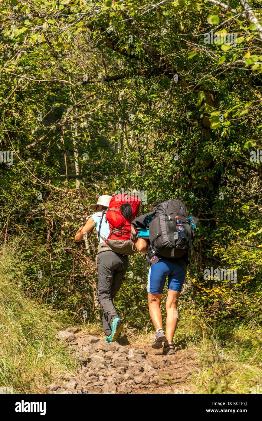 Pilgrims on Via Podiensis in Haute Loire. Auvergne. France - Stock Image