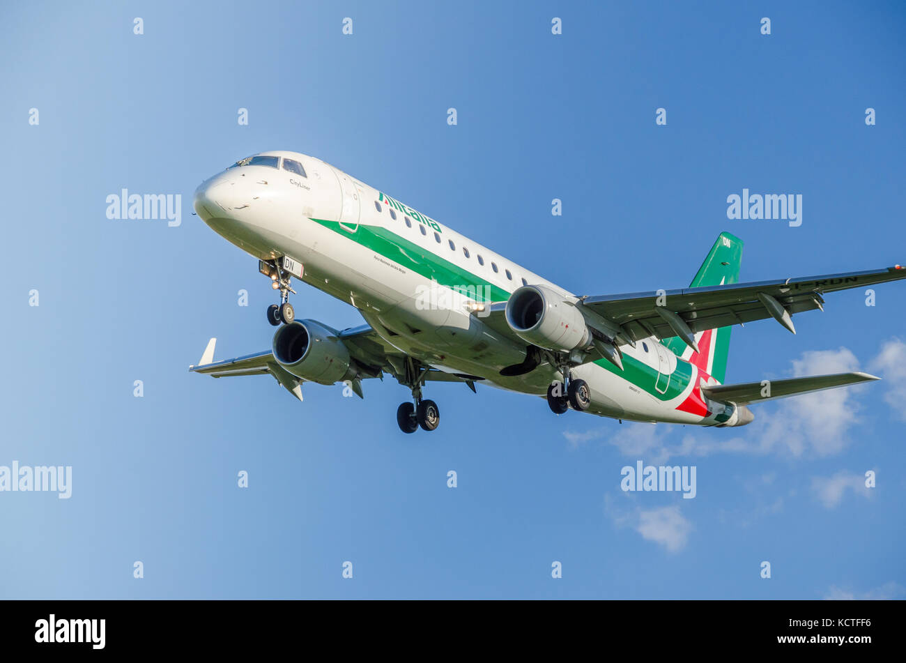 An Alitalia Embraer E175LR Cityliner airplane against a blue sky. These planes operate short-haul flights within - Stock Image