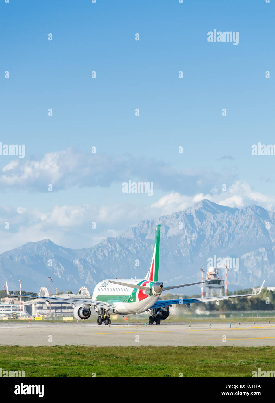 An Alitalia Embraer E175LR Cityliner taxiing at Milan Linate Airport. These planes operate short-haul flights within - Stock Image
