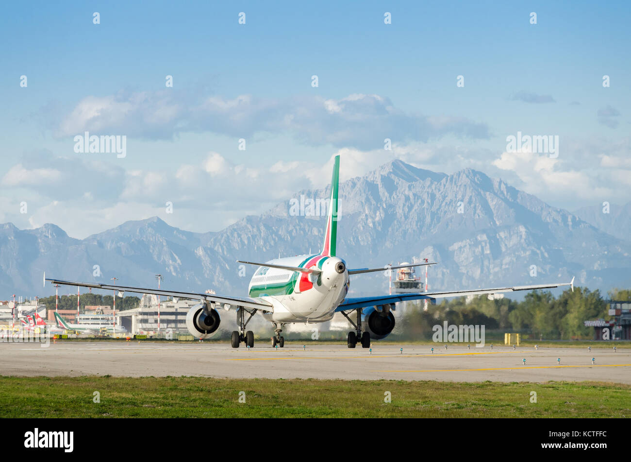 An Alitalia Airbus A319-111 Cityliner taxiing at Milan Linate Airport. These planes operate short-haul flights within - Stock Image
